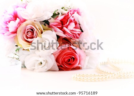 Wedding bouquet with pearl necklace - stock photo