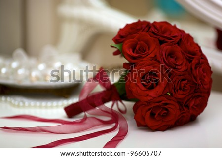 Wedding bouquet with pearls and red tapes - stock photo