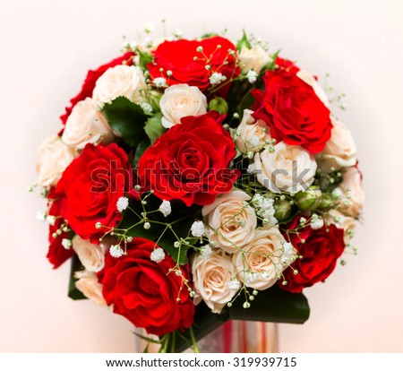 Wedding bouquet with red and pink roses