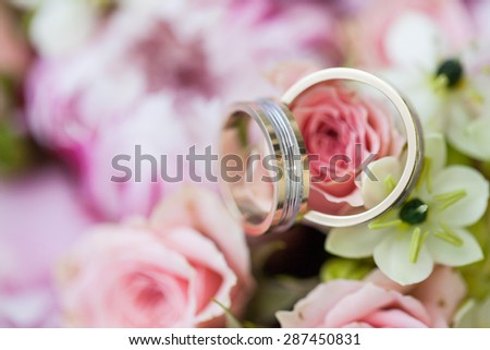 wedding bouquet with rings - stock photo