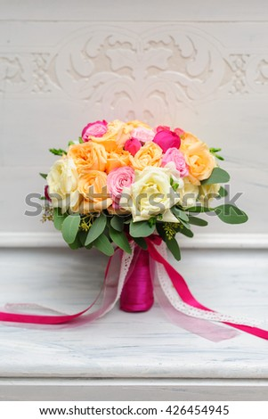 Wedding bouquet with roses and orchids on the white background