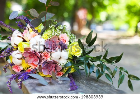 Wedding bouquet with succulent flowers and cotton in retro style outdoors. Close up - stock photo
