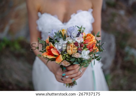 wedding bouquet with tulips in hands of the bride - stock photo