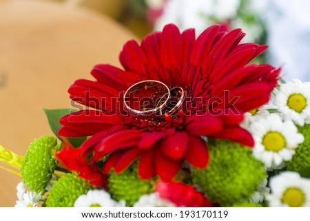 Wedding bouquet with wedding rings in the Ukrainian style - stock photo