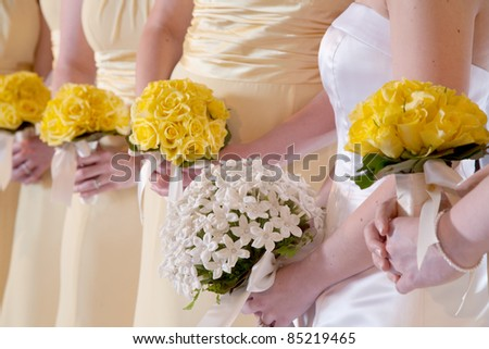 Wedding Bouquets in the Hands of Bridesmaids - stock photo