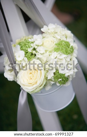 Wedding bouquets of roses at outside ceremony - stock photo