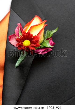 Wedding Boutonniere On Suit Jacket of Groom - stock photo