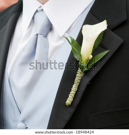 Wedding boutonniere on suit jacket of groom