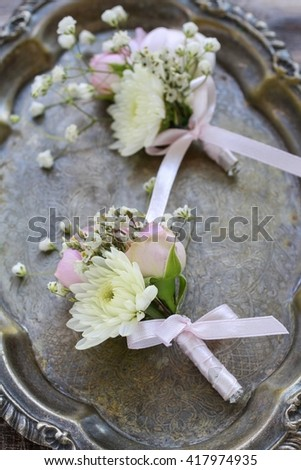 Wedding boutonniere with pink rose, ranunculus and white chrysanthemum. - stock photo
