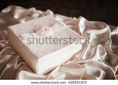 Wedding box for money. Chest and embossed decoration with a ribbon bow. - stock photo