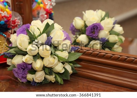 wedding Bridal bouquet by the mirror - stock photo