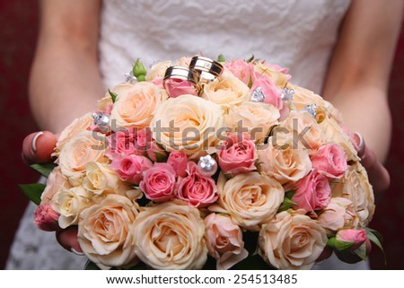 Wedding bridal bouquet of pink roses. - stock photo