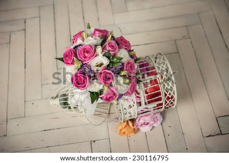 wedding bridal bouquet of roses on the wooden white  floor - stock photo