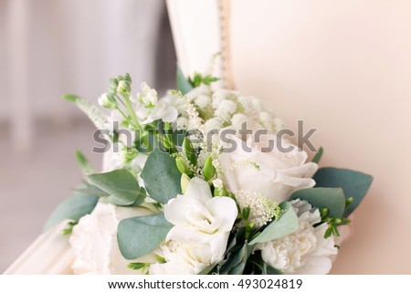 wedding bridal bouquet with white, peach and orange roses. Wedding theme