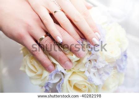 Wedding, bride and groom hands - stock photo