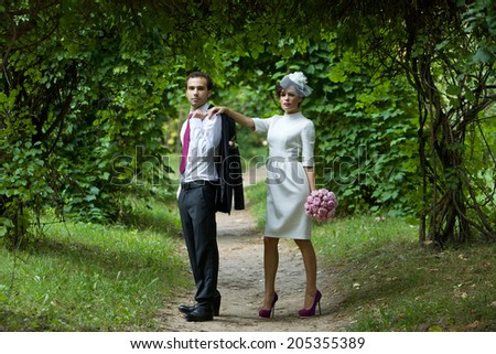 Wedding. Bride and groom in the garden on a summer evening. - stock photo