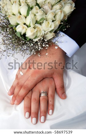 wedding - bride and groom - rings - stock photo