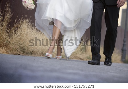 Wedding, Bride and groom walk together - stock photo