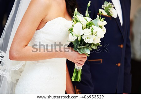 Wedding. Bride, groom, hands and flowers