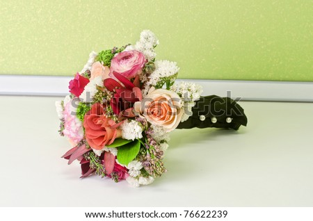Wedding Bunch of flowers at white table - stock photo