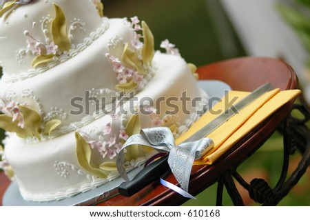 wedding cake and a cutting knife - stock photo