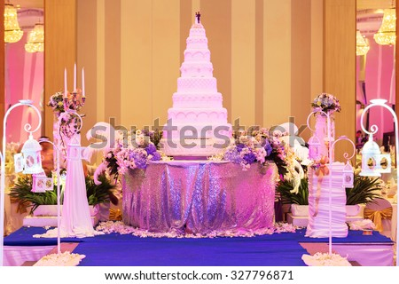 Wedding cake and decorations on stage in wedding ceremony. - (Shallow of focus) - stock photo
