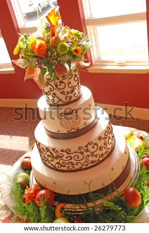 Wedding Cake and flowers - stock photo