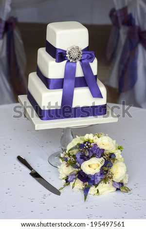 wedding cake and flowers purple theme - stock photo