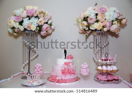 Wedding cake. Candy bar marshmallow on the table in a vase, macaroon, and cupcake, decor vanilla, handmade sweets