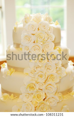 Wedding cake closeup flower details - stock photo