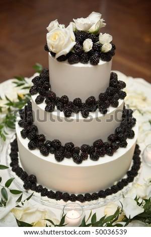 Wedding cake decoraited with berries - stock photo