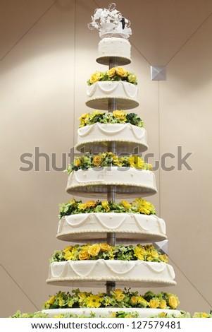 Wedding cake decorate with yellow flower - stock photo
