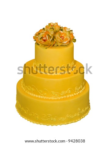Wedding cake decorated with flowers on the top (isolated on white) - stock photo