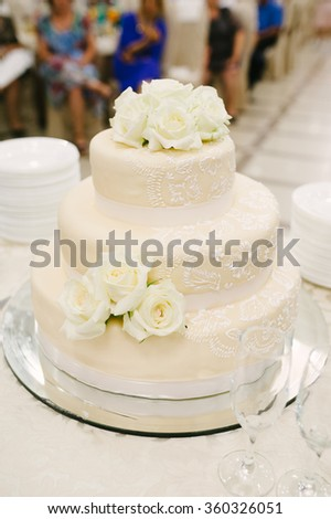 wedding cake decorated with roses