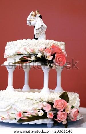Wedding cake ( focus on bride and groom) - stock photo