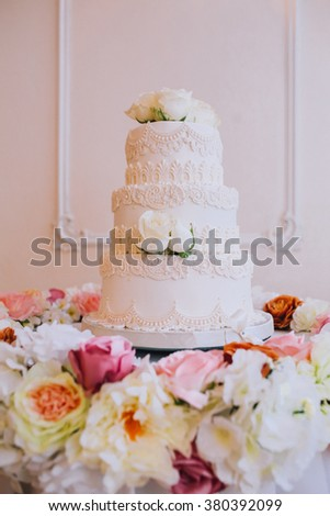wedding cake for bride and groom with candles and flowers