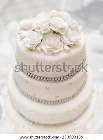 Wedding cake on light background - stock photo