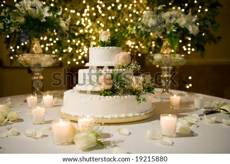 Wedding cake on the decorated table - stock photo