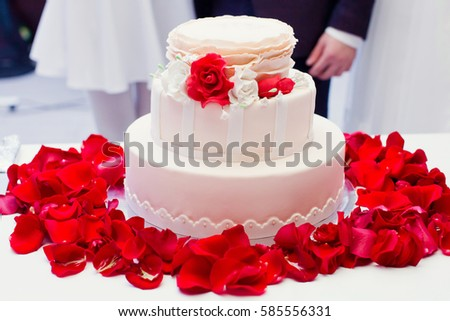 wedding cake decorated with rose petals wedding cake decorated roses stock photo 127353650 22365
