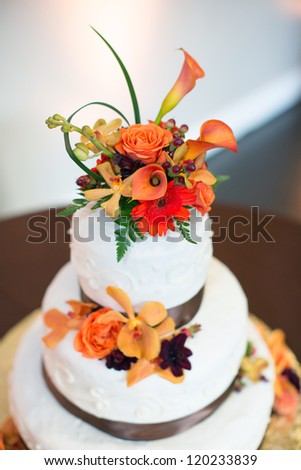 Wedding Cake with Bright Flowers - stock photo