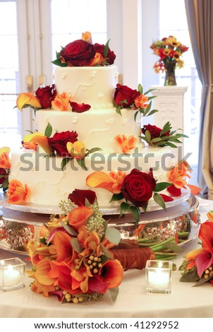 Wedding Cake with flowers on Table - stock photo