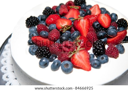 wedding cake with forest fruits - stock photo