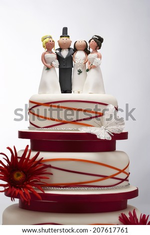 Wedding Cake with Funny Figurines - stock photo