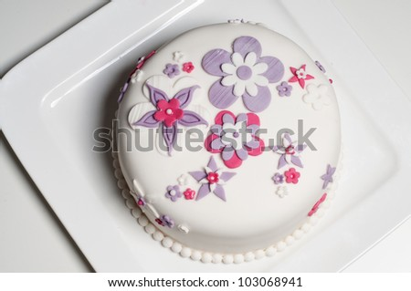 Wedding cake with pink and lilac flowers - stock photo