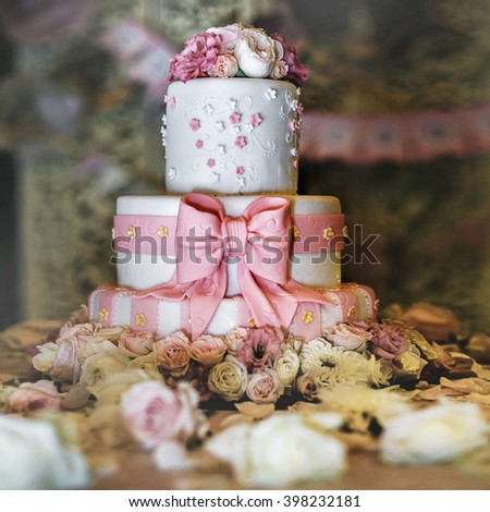 Wedding cake with pink icing and flowers