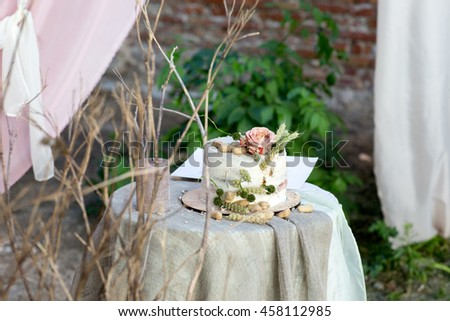 wedding cake with rose and peanuts in old style. Wedding buffet table with copy space