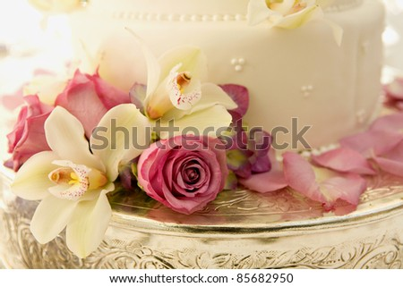 Wedding Cake with Roses and Tropical Flowers - stock photo