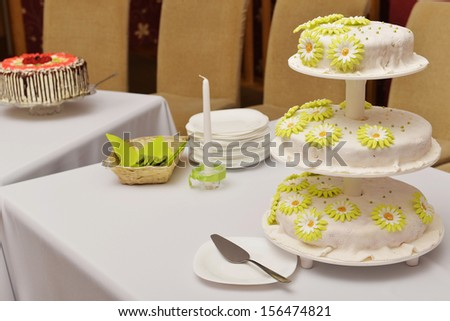 Wedding cake with white frosting and flowers of cream