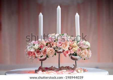 wedding candlestick with flower decoration before wedding ceremony - stock photo