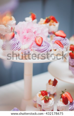 Wedding Candy bar with dessert of whipped cream and strawberries